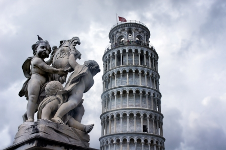 leaning tower of pisa: Statues of cherubs angel and Leaning Tower in Pisa, Italy Stock Photo
