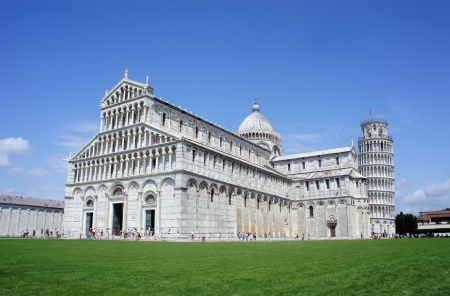 piazza dei miracoli: Pisa Cathedral Square with green grass on a meadow and clear blue sky on the background