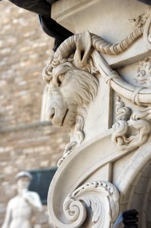 marbles close up: Palazzo Vecchio  Head antique statue with Statue of David on Piazza della Signoria in Florence, Italy