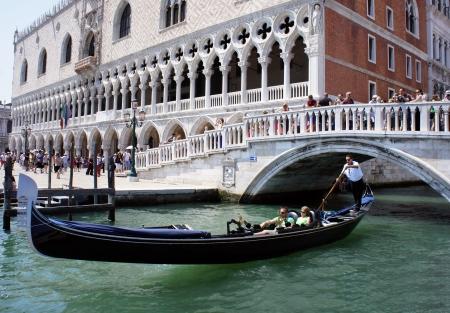 piazza: Gondola under the bridge at the Doge s Palace, Venice, Italy