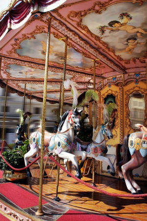 Horse rides on a merry-go-round carousel