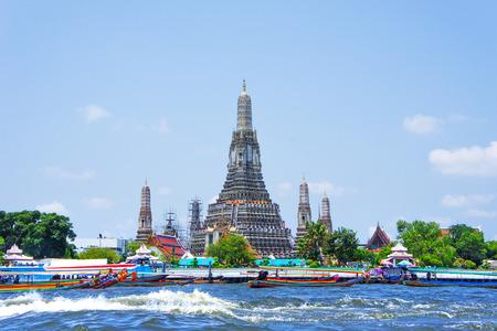 phraya: Wat Arun and long tail motor boat cruise on the Chao Phraya river in Bangkok, Thailand