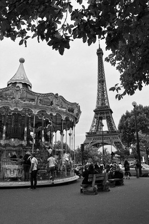 Eiffel Tower and vintage carousel in Paris, France. Retro style