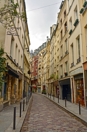 old quarter: Latin Quarter of Paris, France. Narrow cobbled street among old traditional parisian houses in Paris.