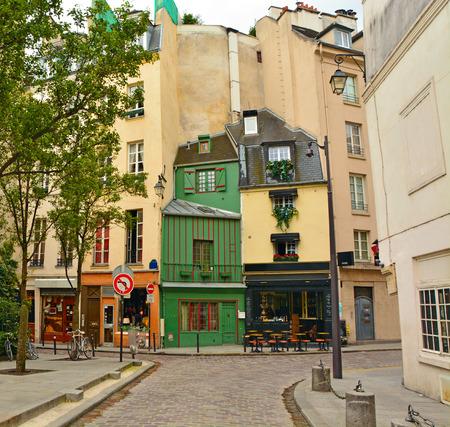 Latin Quarter of Paris. Narrow cobbled street among old traditional parisian houses in Paris, France