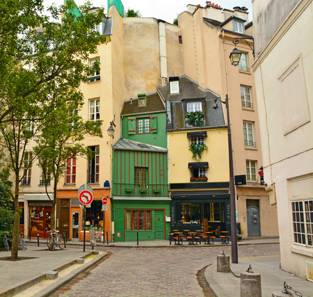 cobbled: Latin Quarter of Paris. Narrow cobbled street among old traditional parisian houses in Paris, France