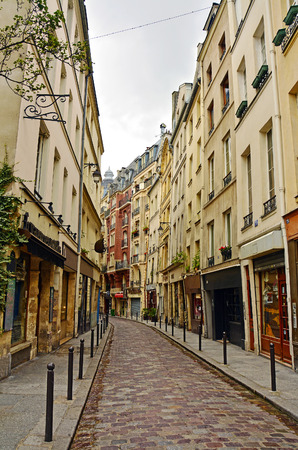 Latin Quarter of Paris, France. Narrow cobbled street among old traditional parisian houses in Paris.