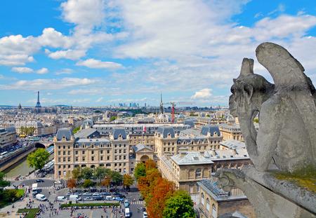 chimera: Notre Dame de Paris Cathedral. Famous Chimera (demon) overlooking the Eiffel Tower. Paris, France