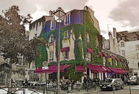 PARIS - August 21: Typical cafe in quarter Marais on August 21, 2014 in Paris, France
