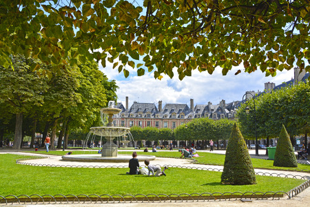 the place is outdoor: Place des Vosges - the old square in Paris, France