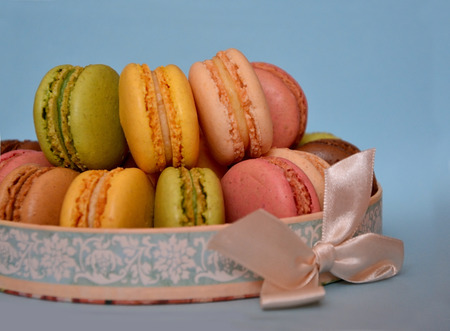 Sweet and colorful french macaroons, traditional Parisian cookie photo