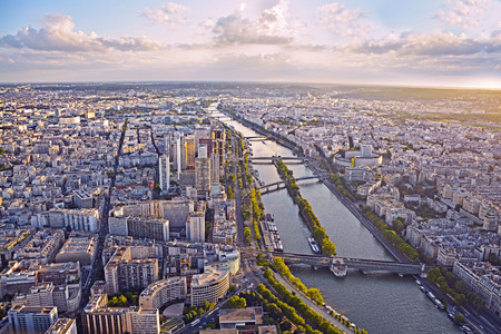 Aerial view of Paris and Seine river from Eiffel tower at sunset. photo