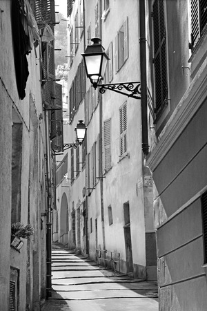 alley: Narrow street in the beautiful old town at sunrise in Nice, France Stock Photo