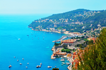 azure coast: Cote dAzur France.  View of luxury resort and bay of French riviera - Villefranche-sur-Mer is situated between Nice city and Monaco. Mediterranean Sea Stock Photo