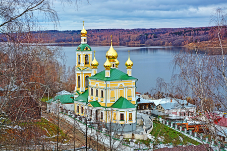 volga river: Autumn view of Volga river and orthodox church in old town Ples, Russia.