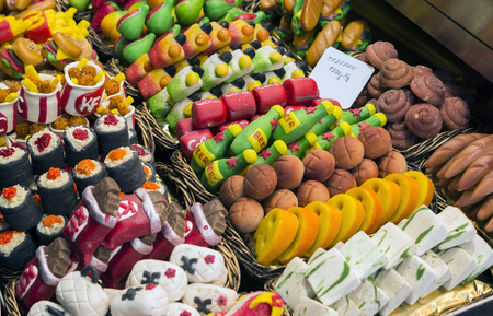 boqueria: Sweets store at La Boqueria market in Barcelona, Spain. Stock Photo