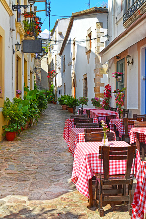 old street: View of outdoor Cafe on narrow Street in the old European Mediterranean city at summer