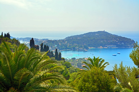 villefranche sur mer: Cote dAzur France.  View of luxury resort and bay of French riviera - Villefranche-sur-Mer is situated between Nice city and Monaco. Mediterranean Sea Stock Photo