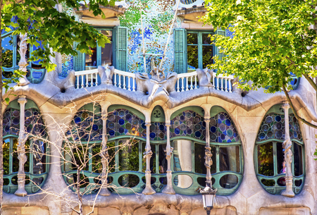 antonio: BARCELONA, SPAIN - JUNE 06, 2015: The facade of the house Casa Battlo (also could the house of bones) designed by Antoni Gaudi with his famous expressionistic style