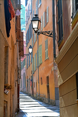 french riviera: Narrow street in the beautiful old town at sunrise in Nice, France Stock Photo