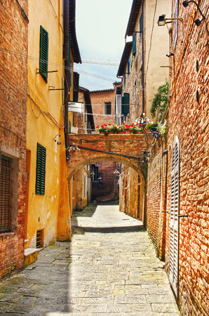 Little street in the old town in Siena, Tuscany, Italy Stock Photo