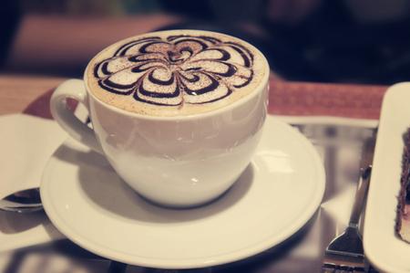 cappuccino foam: Cappuccino or latte coffee cup with art foam