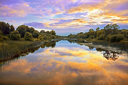 beautiful sky: Beautiful Sunset Landscape with reflection on River Sky and Clouds Stock Photo