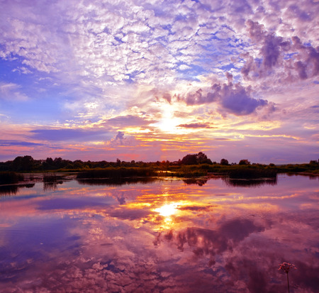 sunset sky: Beautiful Sunset Landscape with reflection on River Sky and Clouds Stock Photo