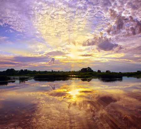 sky reflection: Beautiful Sunset Landscape with reflection on River Sky and Clouds Stock Photo