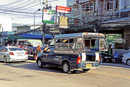 tuktuk: PATTAYA - APRIL 26: Tuk-tuk moto taxi on the street of Pattaya on April 26, 2014, Thailand. Famous moto-taxi called tuk-tuk popular transport and is landmark of the Thailand