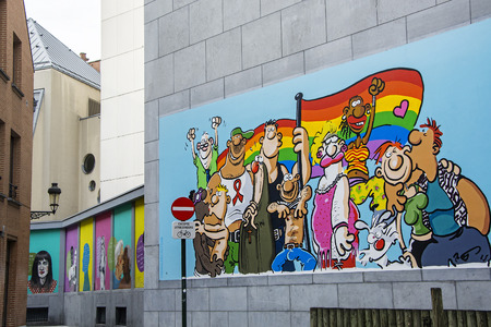 gay parade: BRUSSELS - APRIL 21, 2016: Street art. Colorful graffiti  for the gay pride parade on a wall of house in Brussels.