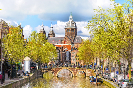 holland: Canal and St. Nicolas Church in Amsterdam at spring day, Amsterdam, Holland, Netherlands