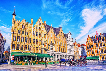 old town house: Colorful old brick house on the Grote Markt square in the medieval town of Bruges, Belgium