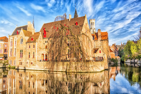 belfort: View of canal, tower Belfort and houses in medieval fairytale town Bruges at morning, Belgium