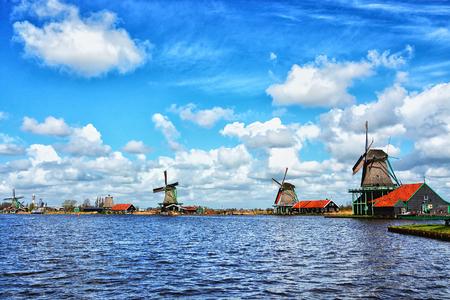 Traditional Hollands wooden windmills, symbol of Netherlands in a charming dutch village Zaanse Schans near Amsterdam