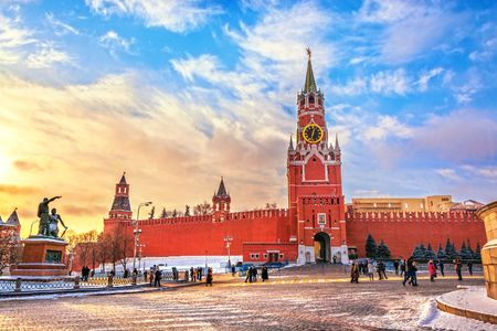 View of the Moscow Kremlin and Spassky Tower with chimes on Red square at sunset winter in Moscow, Russia