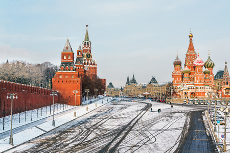 winter road: Moscow Kremlin and Cathedral of St. Basil at the Red Square in winter in Moscow, Russia Stock Photo