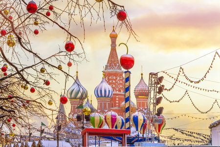 View of Cathedral of St. Basil at the Red Square decorated for New Year and Christmas holidays in winter sunset, Moscow, Russia.
