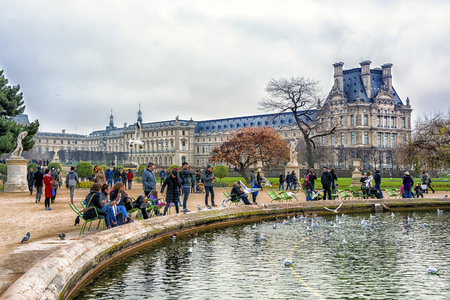 PARIS, FRANCE - DECEMBER 09,2016: Jardin des Tuileries (Tuileries garden) Located between the Louvre Museum and the Place de la Concorde in Paris. Garden was created by Catherine de Medici in 1564. Editorial