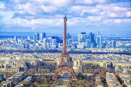 Paris cityscape. Aerial view of the main attractions of Paris Eiffel Tower on background of business district of La Defense, seen from Montparnasse skyscraper, France. Stock Photo