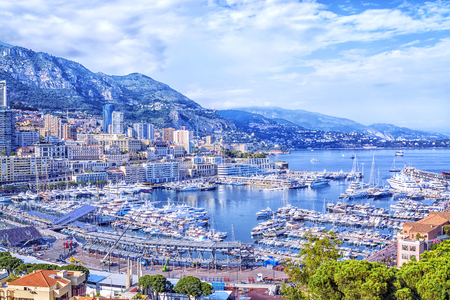 Cote dAzur, Monte Carlo. Beautiful panoramic aerial view of harbor of Monaco with apartments and luxury yachts. Stock Photo