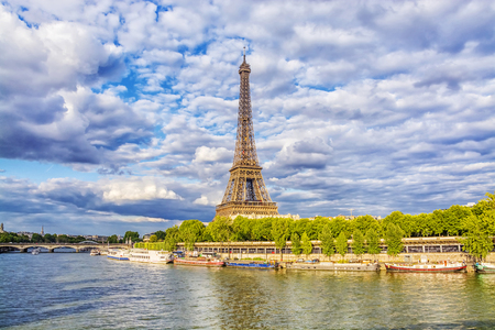 View of Eiffel Tower from the Seine river in Paris at summer evening, France