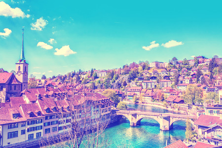 Panoramic view on old town of Bern over the Aare river, capital of Switzerland. Travel background with retro vintage  filter