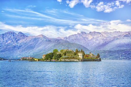 Isola Bella Island on the beautiful Lake Lago Maggiore in the background of the Alps mountains, Stresa, Italy