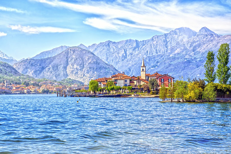 Isola Dei Pescatori Island on the beautiful Lake Lago Maggiore in the background of the Alps mountains, Stresa, Italy
