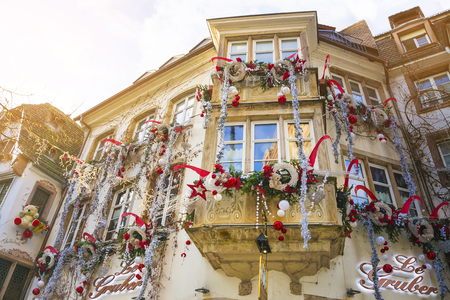 Strasbourg, Alsace, France - December 12, 2016: Facades and windows of houses decorated for Christmas in the medieval city of Strasbourg - the capital of Christmas