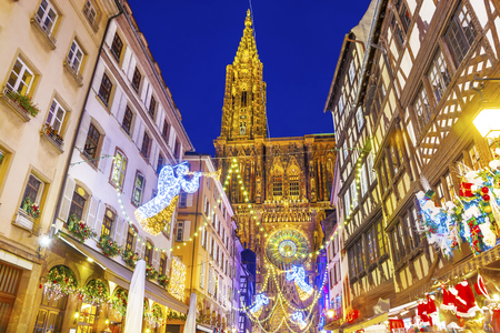 Festive Christmas illumination and decorations on streets of Strasbourg - capital of Christmas, Alsace, France.