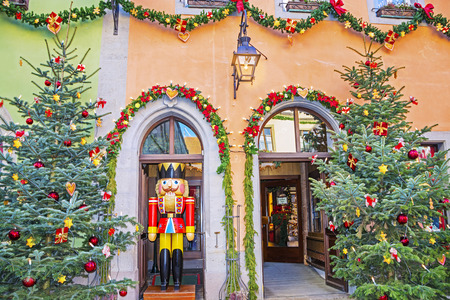 ROTHENBURG OB DER TAUBER, GERMANY - December 13, 2016: Christmas trees and a wooden toy The Nutcracker at a traditional Christmas market of old fairytale town of Rothenburg ob der Tauber, Bavaria