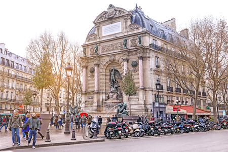 PARIS, FRANCE - DECEMBER 10,2016: Street view of Place Saint-Michel with ancient fountain in Paris