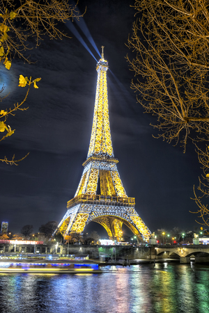 PARIS, FRANCE - DECEMBER 09,2016: Eiffel Tower light performance show in Paris by night. Eiffel Tower is the most visited monument in France and use 20,000 light bulbs in the night show. Editorial